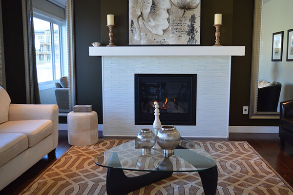 Living room with a white fireplace