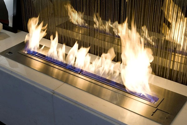 Fire coming through modern fireplace